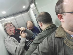 Helps we are stuck in a lift!